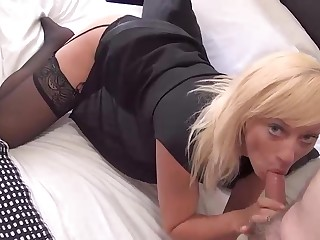 Lovely Axa Jay gets on with giving her photographer a nice blow job