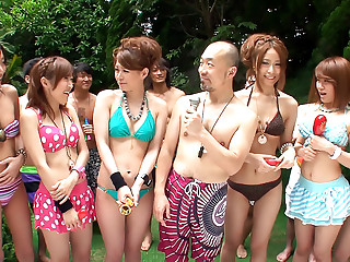 Girls in bikinis are partying in the swimming pool