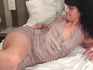 Horny housewife getting ready with her dildo
